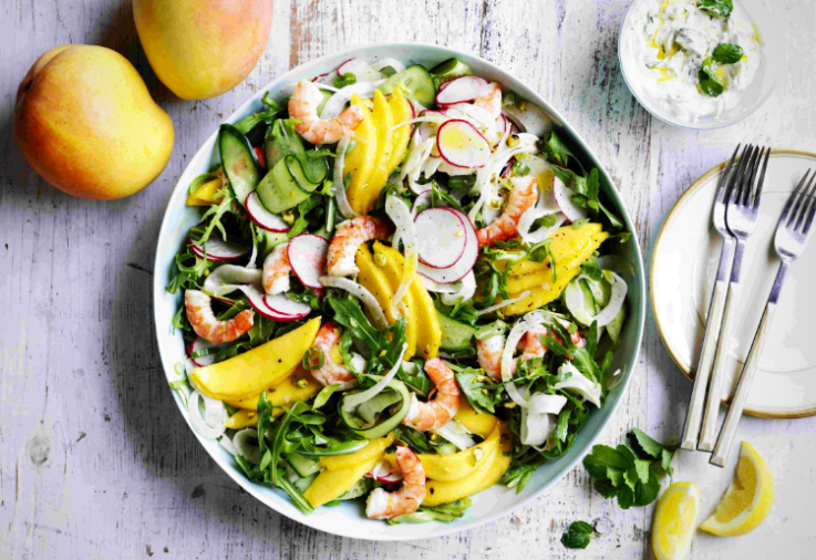 Mango Salad with Prawn and Fennel served in a big bowl with lots of green salad leaves