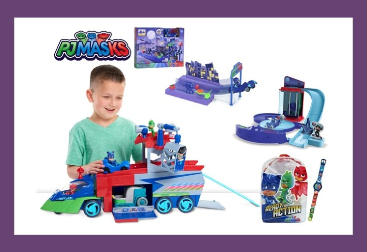 A young boy playing with PJ Masks merchandise