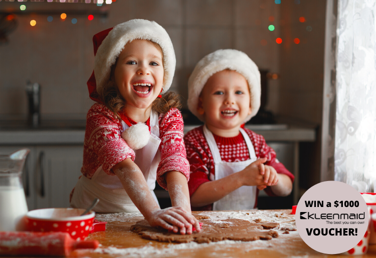 Two kids baking Christmas goods in a Kitchen
