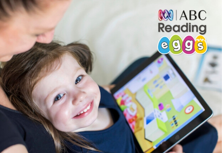 Reading Eggs Review Main Image - Mother with Daughter looking at Reading Eggs on tablet