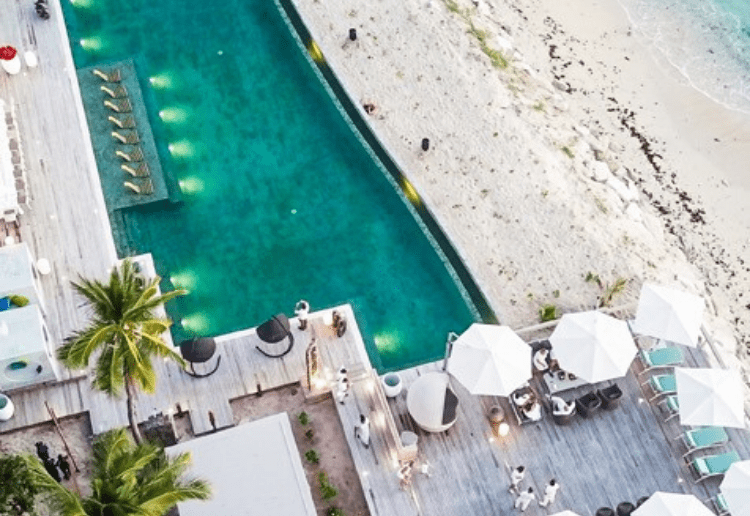 A high angle photograph of the pool and surrounding area at the Vomo resort in Fiji.