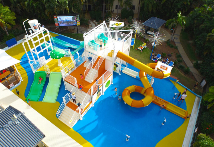 A colourful mini waterpark at Turtle Beach Resort on the Gold Coast, one of the best family resorts in Gold Coast. Pic via: Turtle Beach Resort/Facebook.