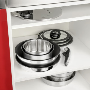 Cookware sitting neatly in a cupboard