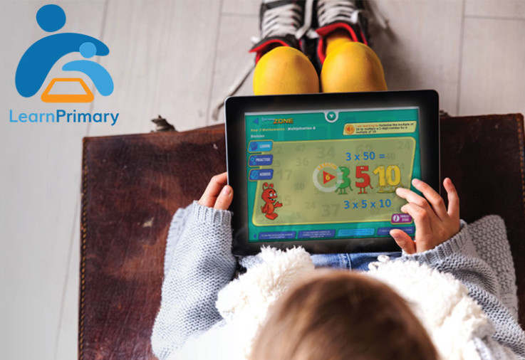 A child playing an educational app - Learn Primary