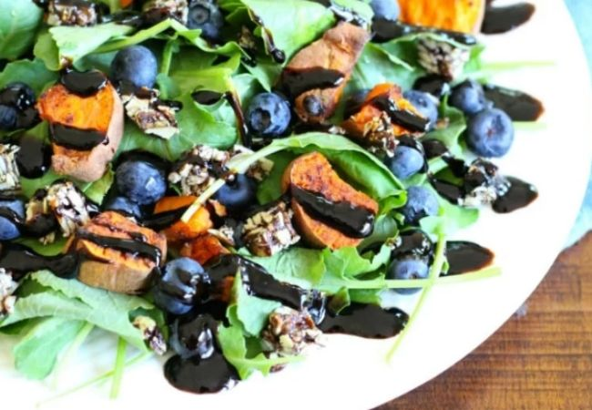 Salad Recipes - blueberries and creamy chunks of sweet potato combined with salad leaves and drizzled with a balsamic vinegar dressing