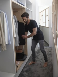 Man packing Tefal IXEO into wardrobe