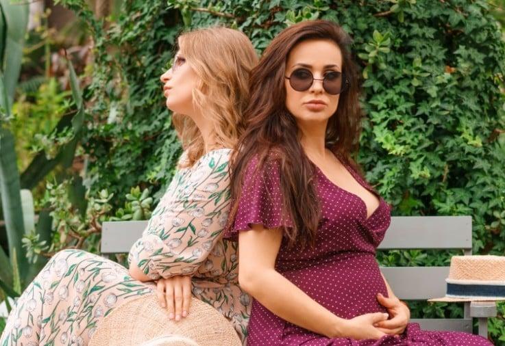 pregnant woman sharing baby news