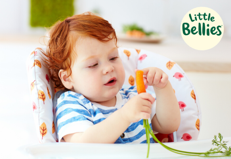 image of toddler eating at mealtime for the little bellies sponsored post
