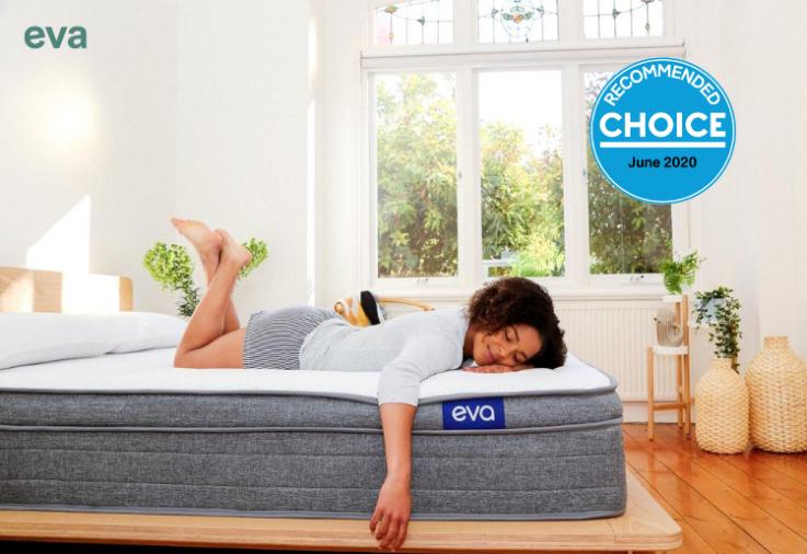 A woman lying on an Eva mattress in a white fresh room