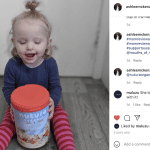 toddler holding the nutura organic tin for the Nutura Organic Stage 3 Toddler Milk Drink review