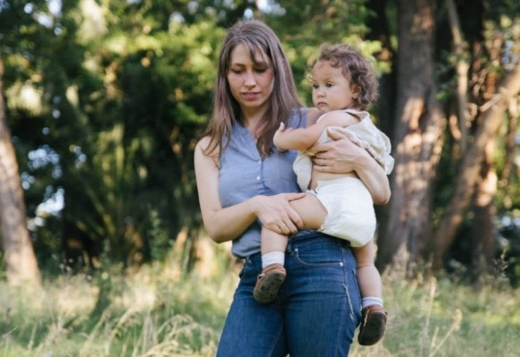 Mum with baby wearing Eco Nappies_What Are Eco Nappies Made From And Where Can I Buy Them